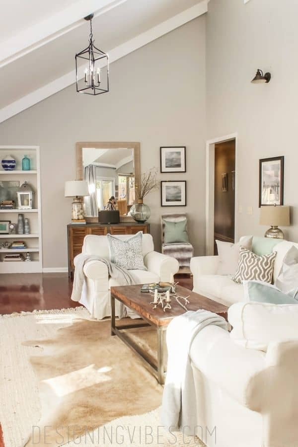 Passive used in the family room with white slipcovered furniture and wood floors.