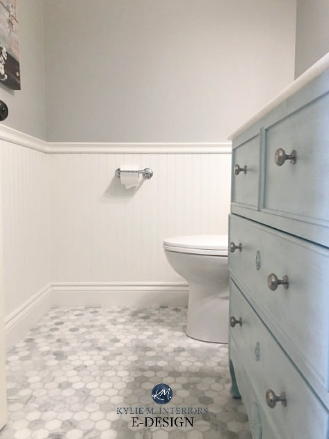 Stonington Gray in a bathroom with white wainscotting and a Carrera mosaic floor tile.