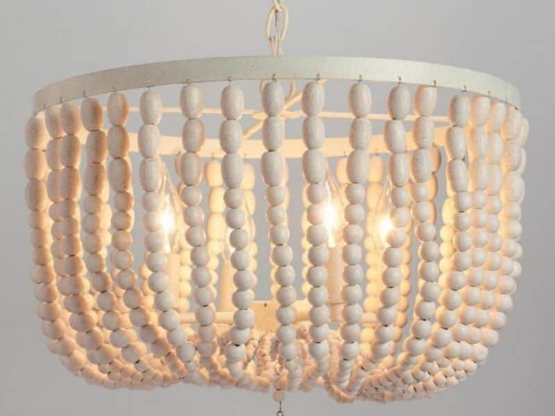 A smaller light fixture with white beads.