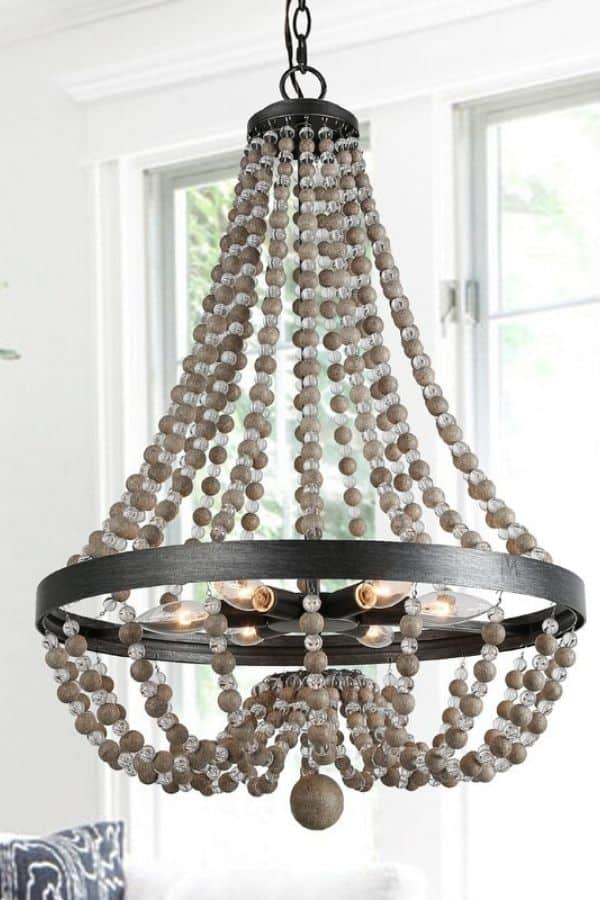 A gray beaded chandelier with crystal beads in between the gray beads.