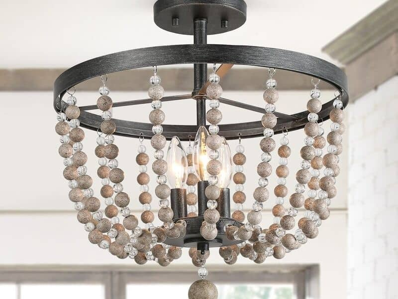 A semi flush beaded chandelier with dark metal and gray and crystal beads.