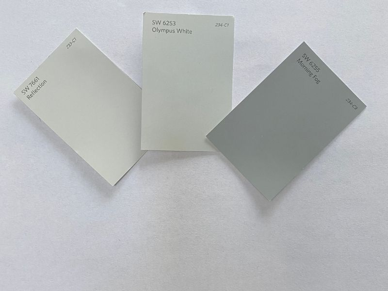 These cool-toned paint colors are placed on a white sheet of paper to show the blue undertones.