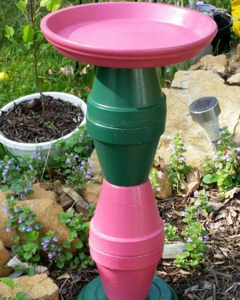 Terra Cotta pots painted and made to create a bird bath.