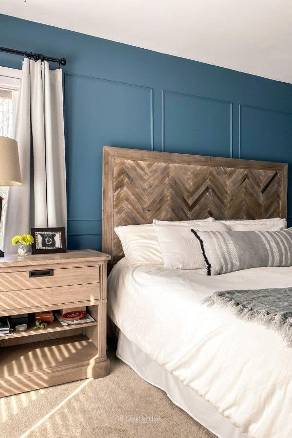 This is a smokey blue wall in my bedroom with my herringbone headboard.