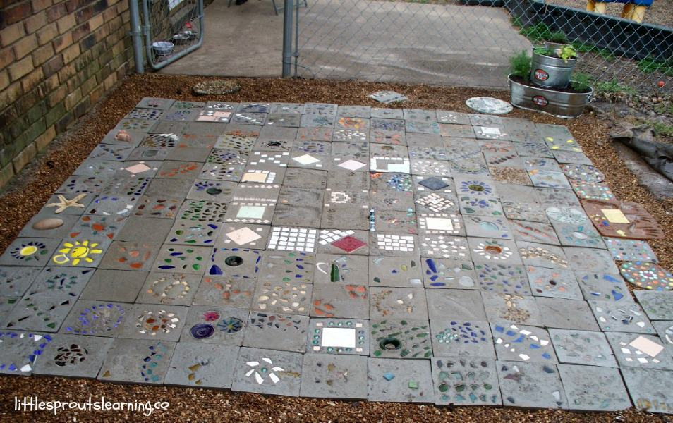 Kids made cement pavers with gems and parents took them and turned it into a paver patio,