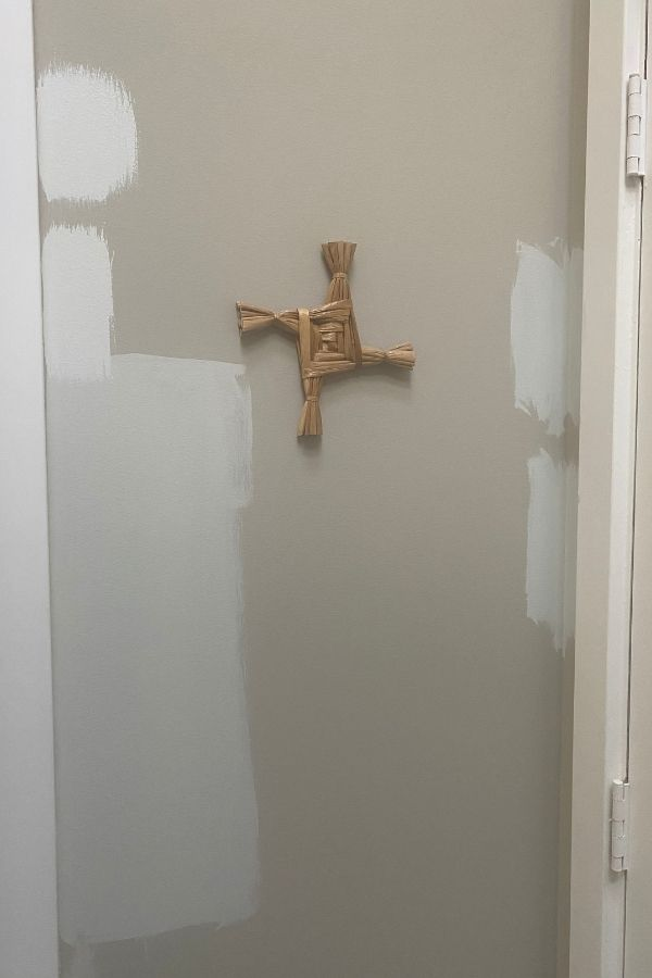 This wall has about 6 different paint colors swatched on it around my St. Brigid Cross.