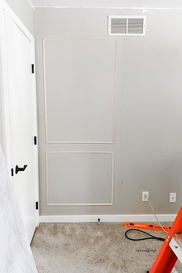 I have one set of picture frame molding done on my largest wall.