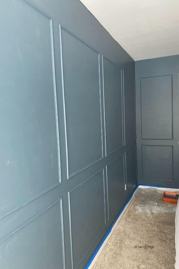 I have done one coat of paint on the walls in a dark smokey blue color.