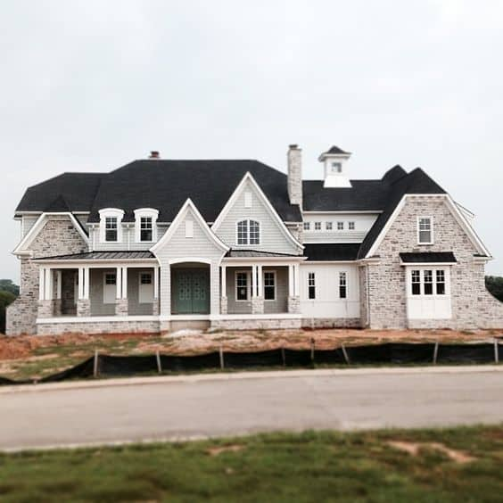 A new build home with Stonington Gray on the siding with white trim.
