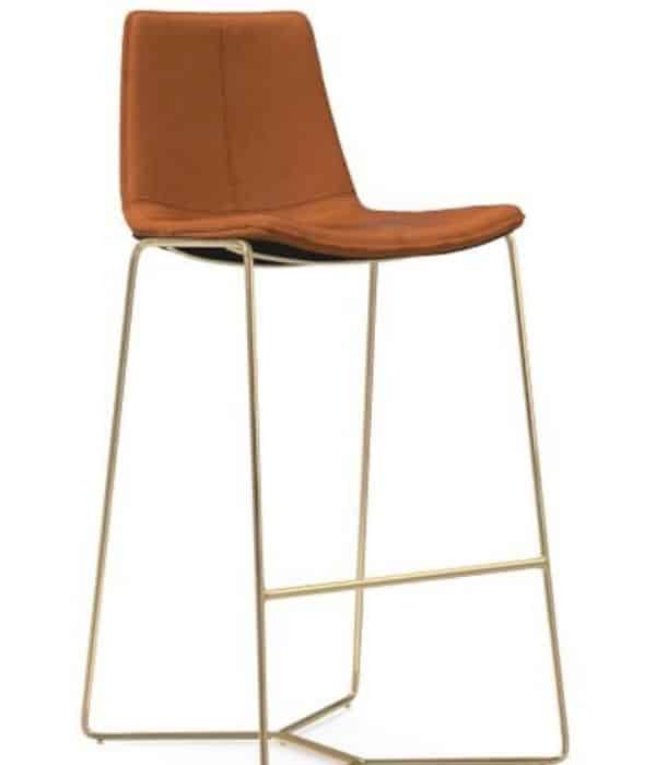 A faux cognac leather seat with a gold base.