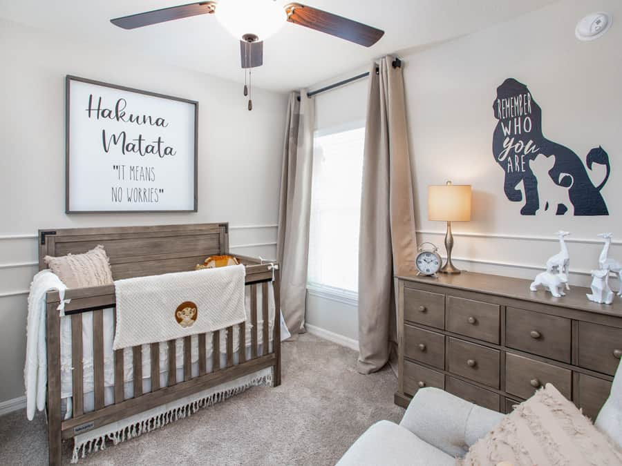 This nursery is so pretty with gray-brown furniture and accessible beige on the walls.