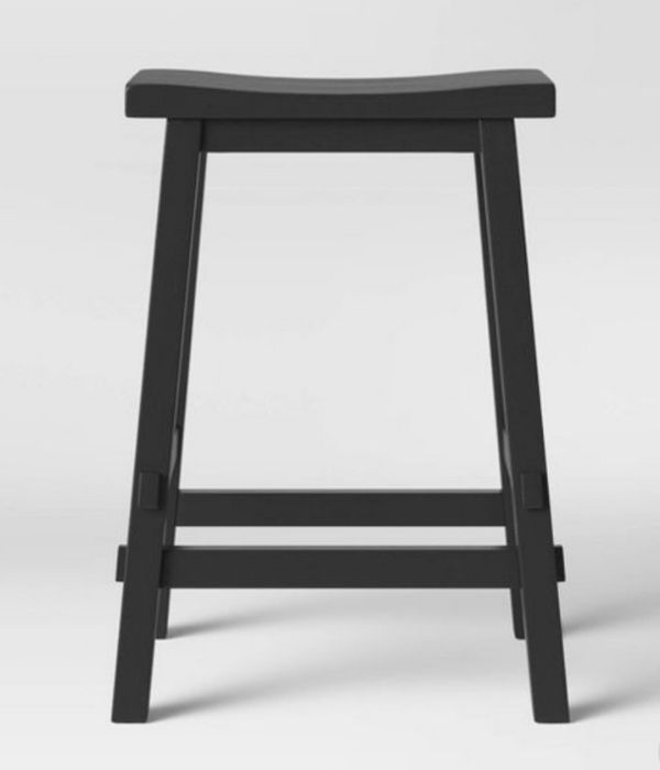 Black painted wooden bar stool that is rectangular and has no back.