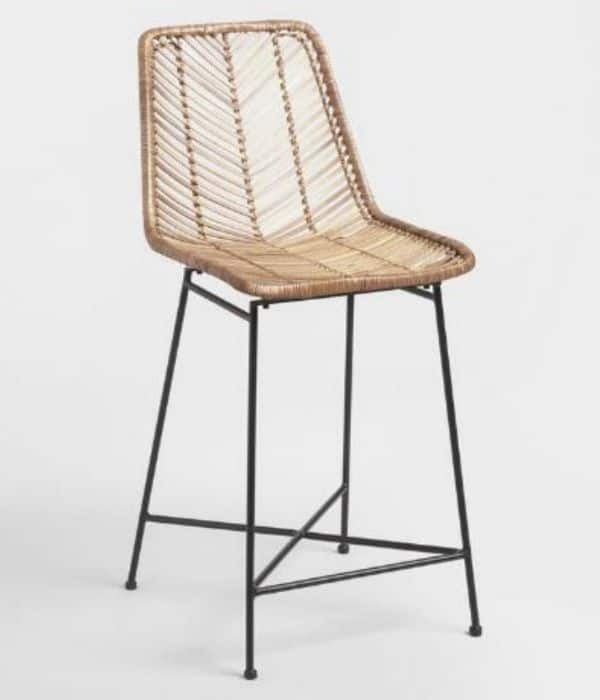 This is a woven rattan bar stool in light beige with a black metal base.
