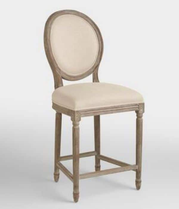 Brownish gray distressed wood base with a linen upholstered seat and a round upholstered back.