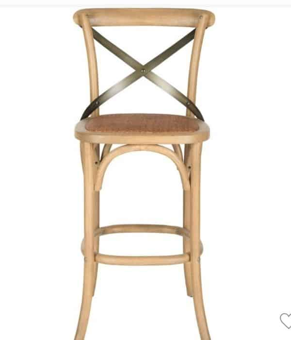 This wooden stool has a metal X detail on the back and a rattan seat.