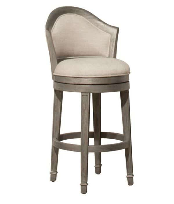 Brown wooden round bar stools with a light beige upholstered seat and back.