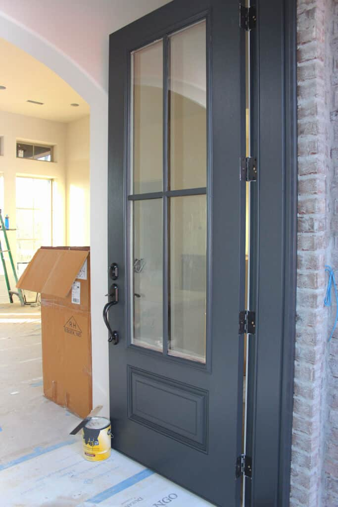 A front door painted in Wrought Iron.