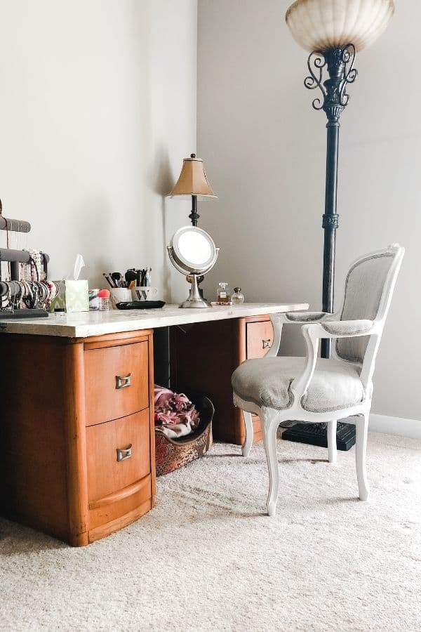This shows the wood nightstands and wood top with the french chair I made over.