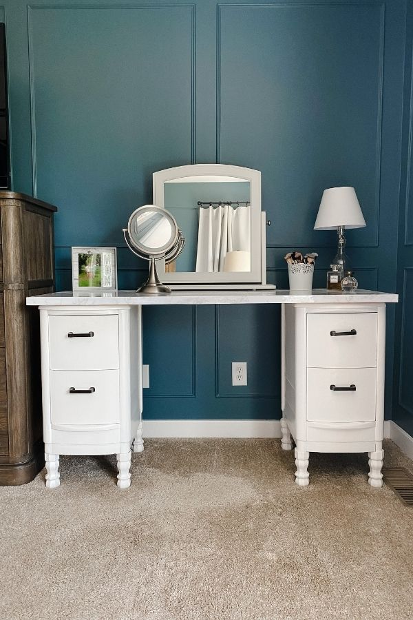 Here is the antique vanity makeover all finished with my makeup brushes, perfume and magnifying mirror.