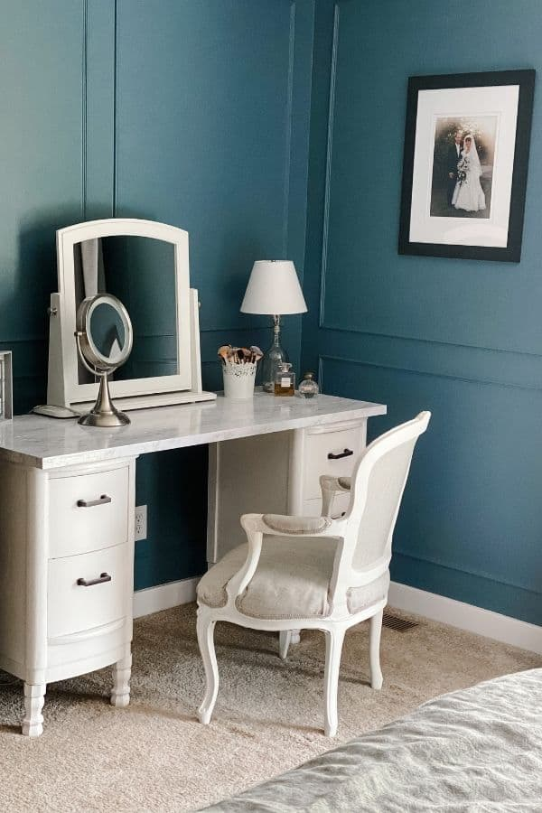 Here is a side shot of the antique vanity makeover with the reupholstered french chair and the diy picture frame molding.