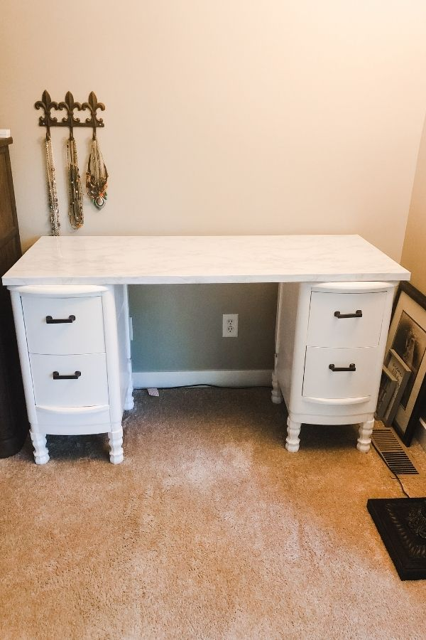 The nightstands have been painted and the contact paper has been attached.