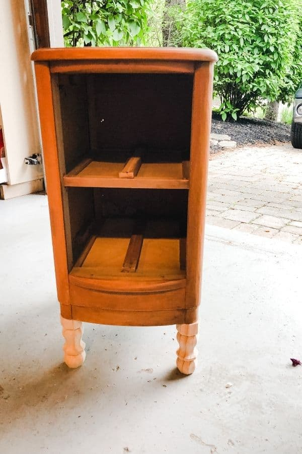 The night stand is turned right side up with new feet and the drawers are missing.