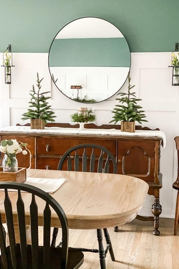 My dining room decorated for winter with white board and batten on the bottom 2/3 of the walls with Studio Blue Green on the top 1/3.