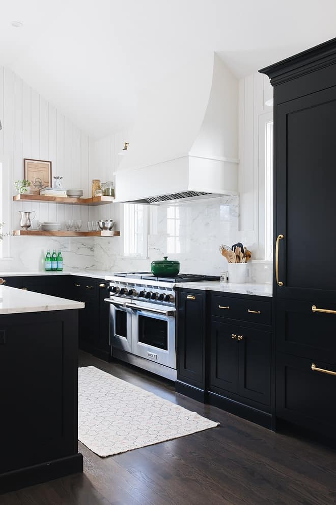 A kitchen with Onyx on the cabinets, gold hardware and marble on the counters and backsplash.