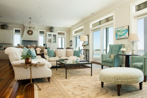 Grant Beige on the walls of a family room with lots of accents of turquoise on the art, pillows and chairs.