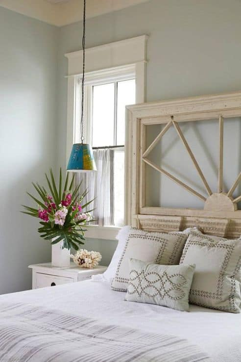 A bedroom with white trim around the windows and Tranquility painted on the walls.