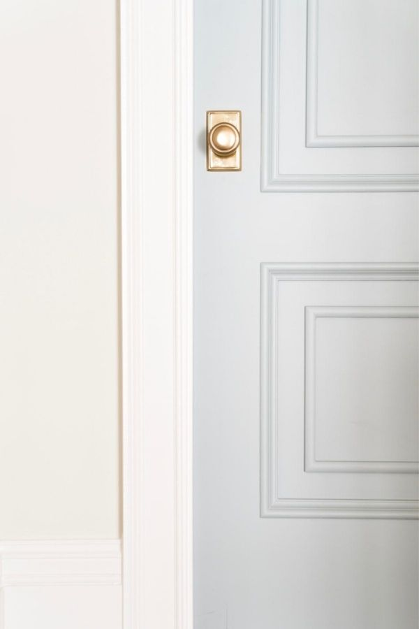 Benjamin Moore Boothbay Gray on a door with white trim and warm white paint color on the walls.