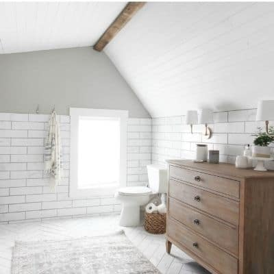A bathroom with Mindful Gray on the wall above white subway tile.