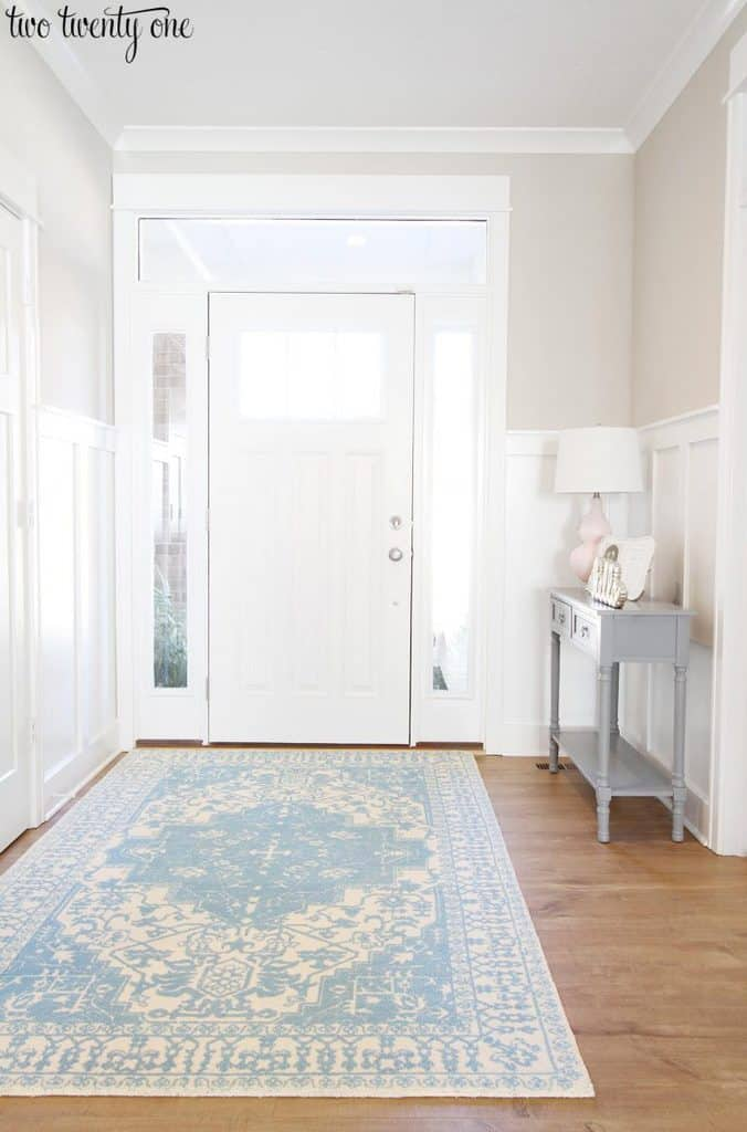 An entryway with white board and batten and Worldly Gray on the walls.
