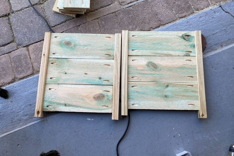 Here you can see I have attached the fence boards to two balusters and finished two sides of the planter.