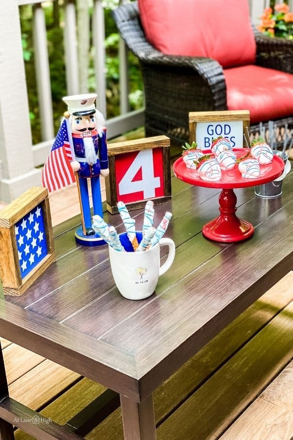 the table with my farmhouse signs and food for the holiday.