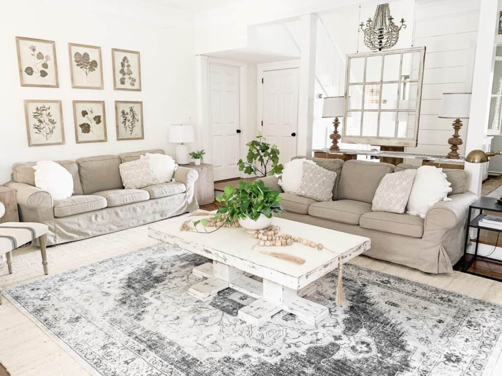 This family room has Alabaster on the walls, gray furniture and white throw pillows.