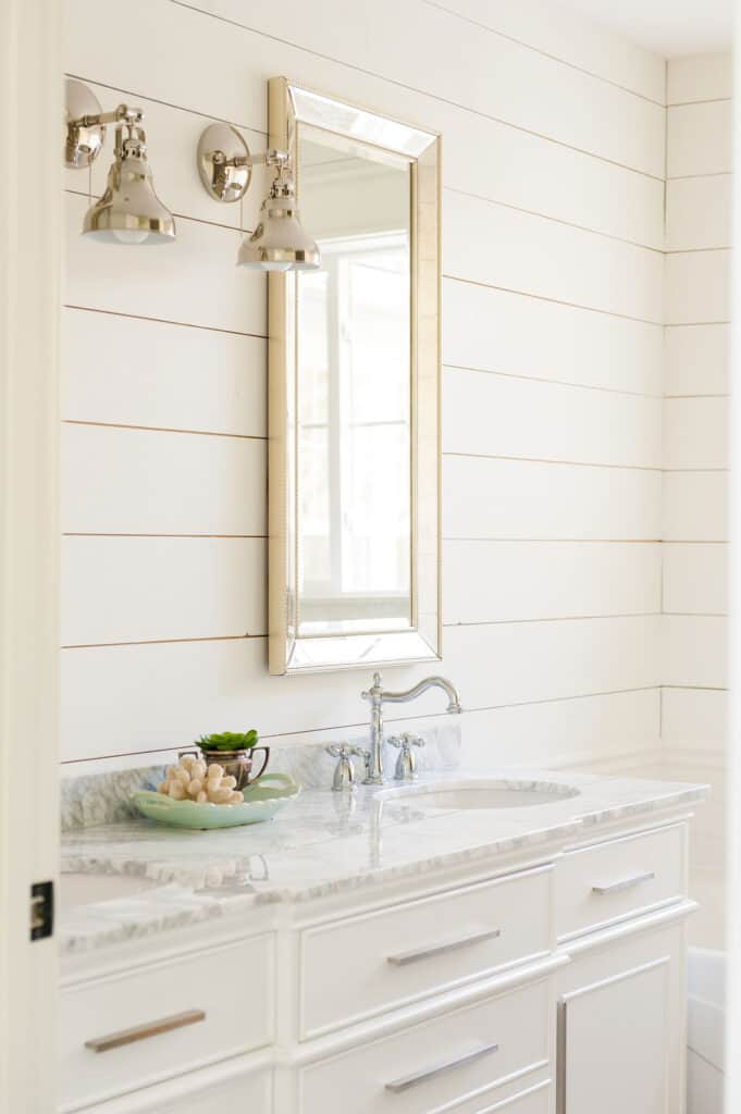 This shows Alabaster on the shiplap walls of a bathroom.