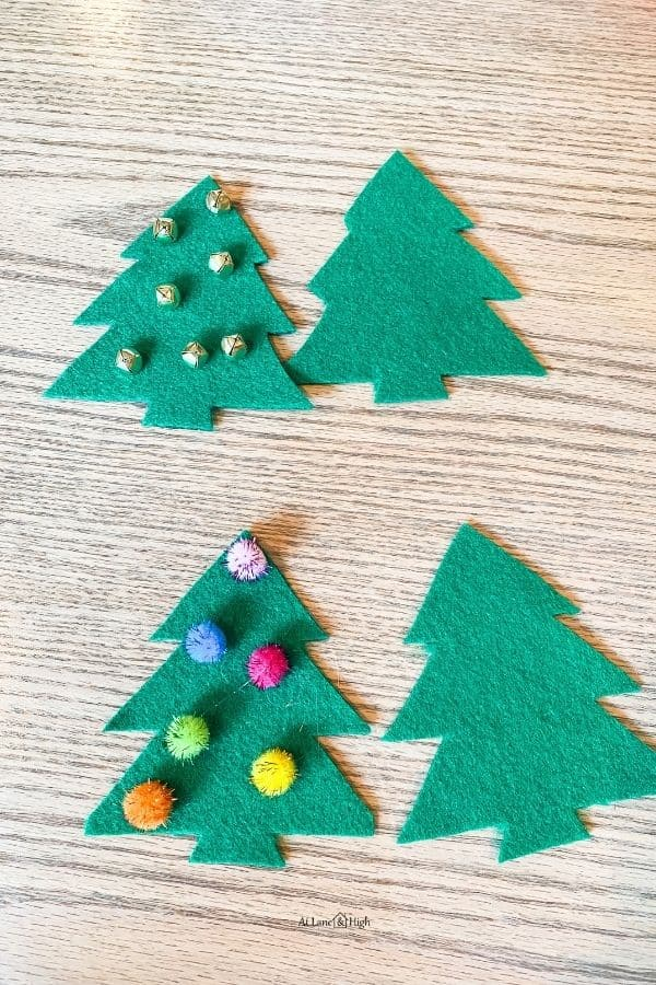Here I added jingle bells to one of the trees and pom-poms to the other.