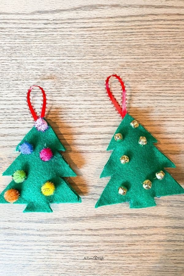 The felt trees glued together with stuffing inside and a ribbon glued to the back for hanging on a tree.