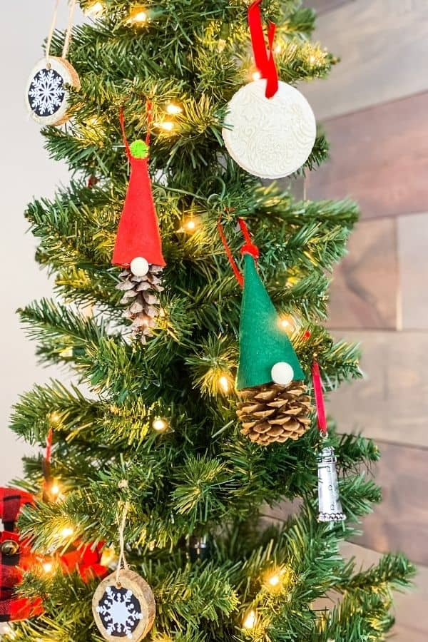 Here are the two pinecone gnome ornaments hanging on the Christmas tree.