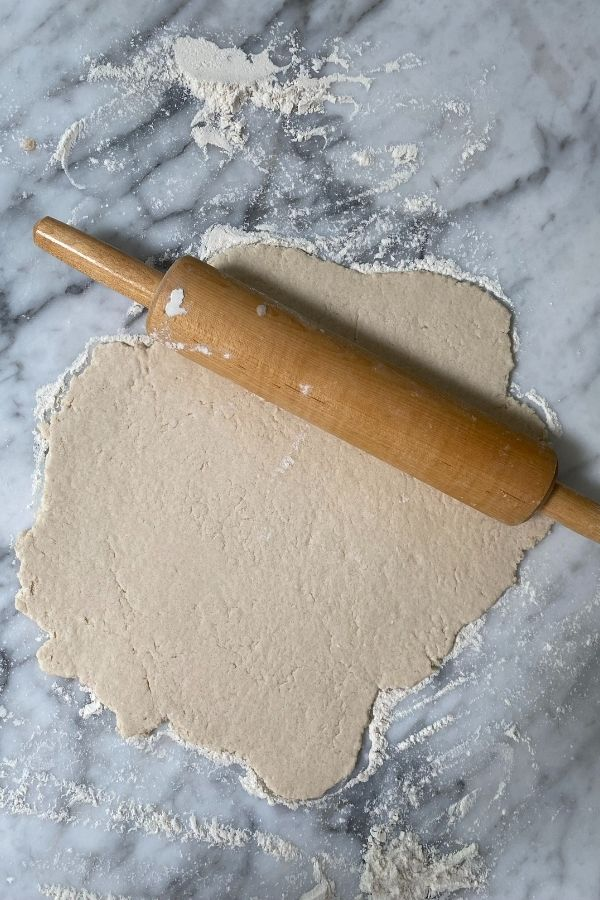 The salt dough rolled out on the counter.