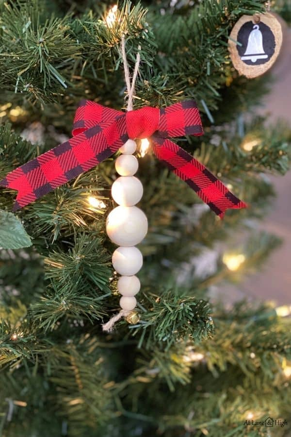 The wood bead ornaments hanging on the Christmas tree.