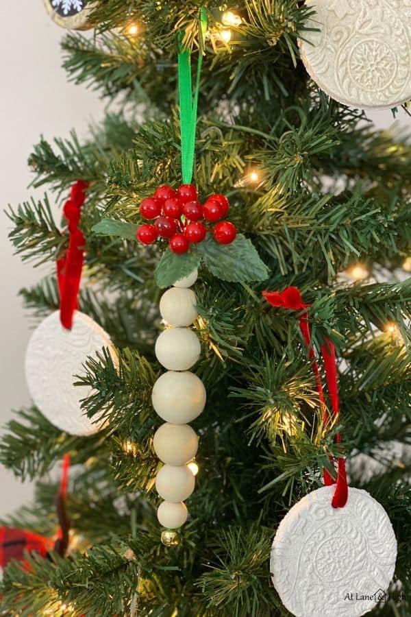 DIY Wood Bead Ornaments hanging on a Christmas Tree.