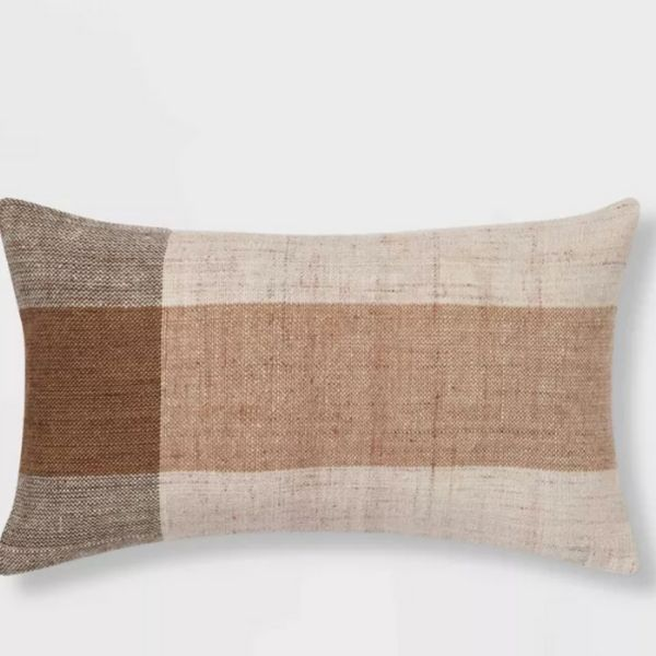 This is a lumbar pillow with a vertical stripe on the left side and a horizontal stripe in the center.