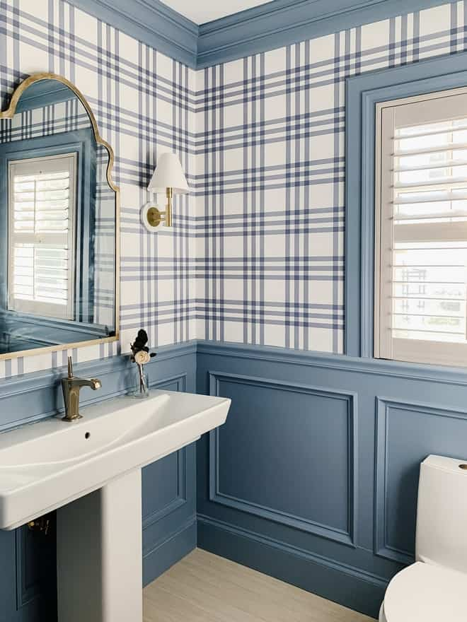 Daphne is used on the wainscoting of a bathroom with blue and white plaid wallpaper on the upper walls.  The blue in the plaid matches the Daphne color on the bottom.