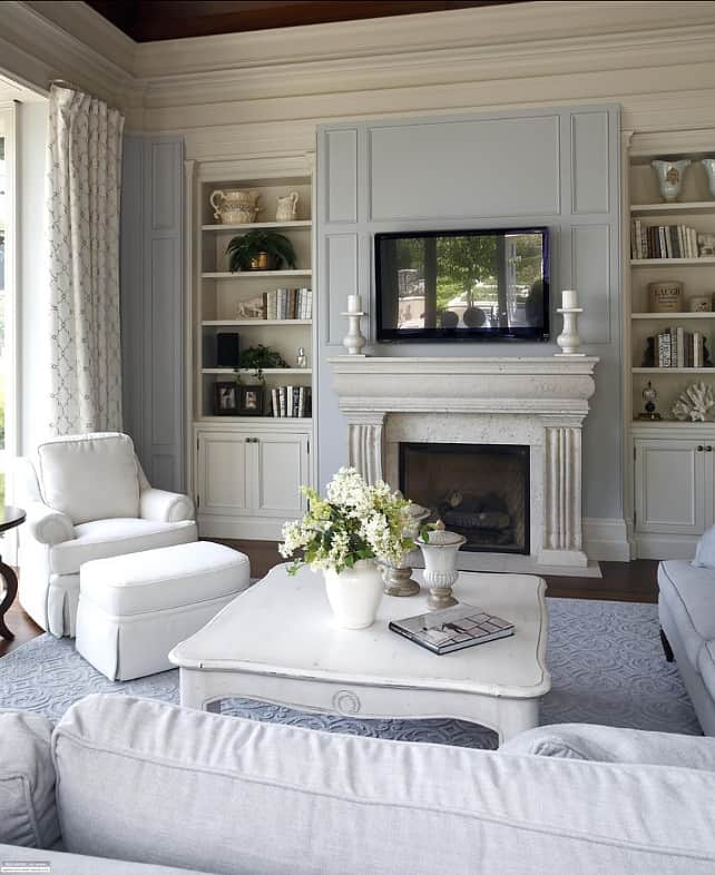 A family room with Eternity on the walls with Edgcomb Gray on the trim and dark hardwood floors with a  gray and white area rug.