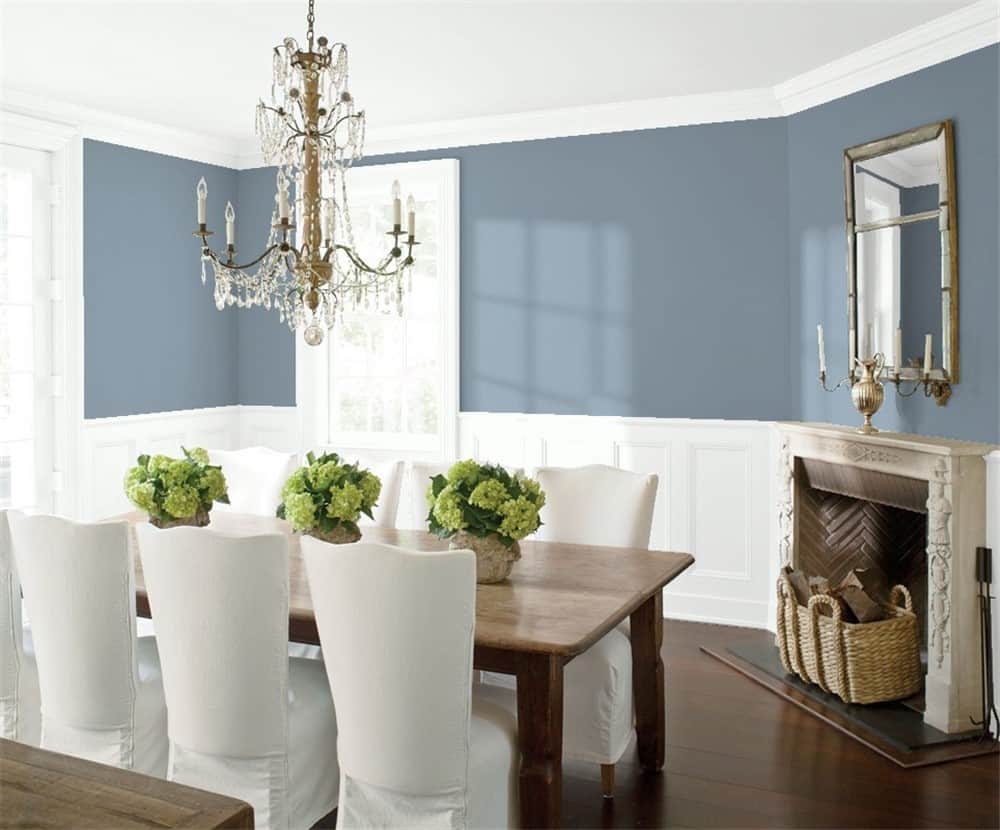 Mineral Alloy is on the upper walls of this dining room with white wainscoting on the bottom.